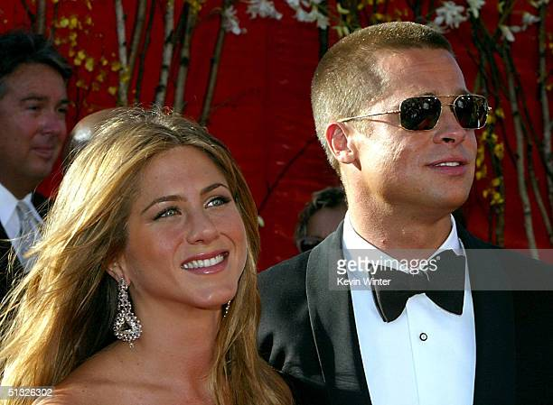 Actress Jennifer Aniston and Actor/husband Brad Pitt attend the 56th Annual Primetime Emmy Awards on September 19 2004 at the Shrine Auditorium in...