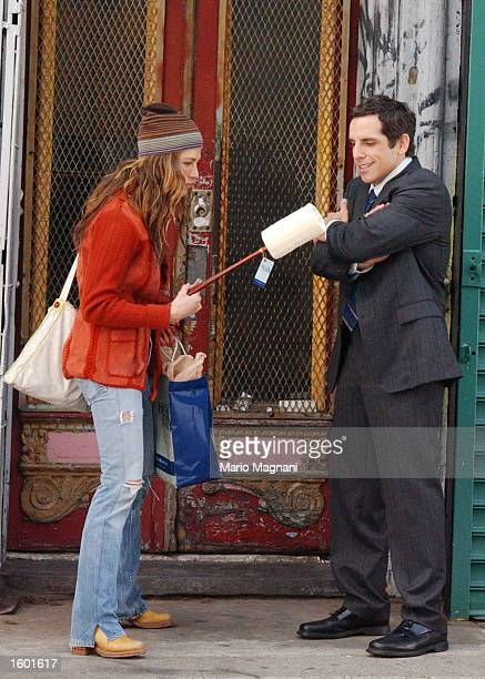 Actress Jennifer Aniston and costar actor Ben Stiller stand on the comedy set of a still unnamed movie directed by John Hamburg November 10 2002 in...