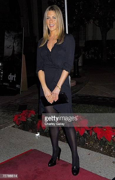 Actress Jennifer Aniston arrives at the premiere screening of the FX Network's 'Dirt' at the Paramount Theater on December 9 2006 in Los Angeles...