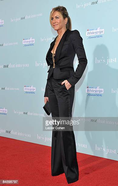 Actress Jennifer Aniston arrives on the red carpet at the Warner Bros Los Angeles Premiere of 'He's Just Not That Into You' held at the Grauman's...
