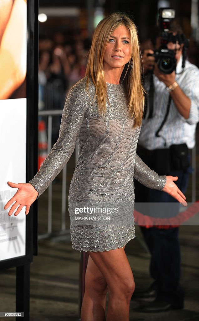 Actress Jennifer Aniston arrives on the red carpet for the premiere of her new Universal Pictures movie 'Love Happens' at Mann's Village Theater in Los Angeles, on September 15, 2009. Aniston plays the role of Eloise in the movie which also stars Aaron Eckhart in the male lead role and which opens in US cinemas on September 18. AFP PHOTO/Mark RALSTON