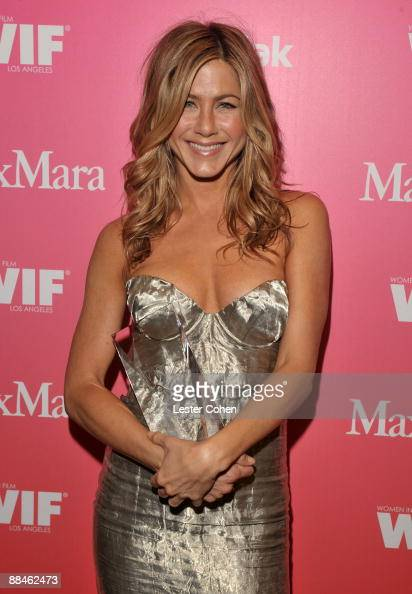 Actress Jennifer Aniston Crystal Award honoree poses backstage at the Women In Film 2009 Crystal Lucy Awards at the Hyatt Regency Century Plaza on...