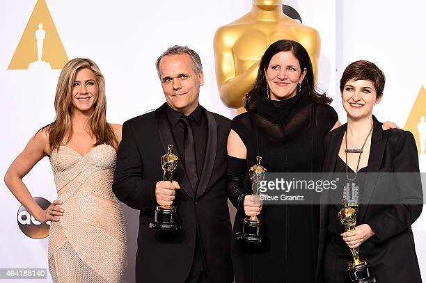 Actress Jennifer Aniston film editor Mathilde Bonnefoy director Laura Poitras and producer Dirk Wilutzky pose in the press room during the 87th...
