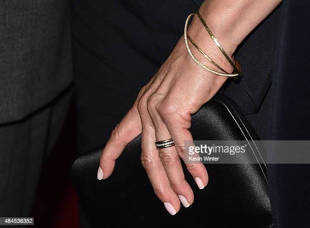 Actress Jennifer Aniston jewelry detail attends the premiere of Lionsgate Premiere's 'She's Funny That Way' at the Harmony Gold Theatre on August 19...