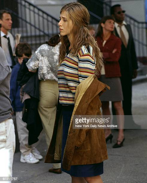 Actress Jennifer Aniston lowers her coat during break in filming on a hot July day on W 21st St Aniston plays a teacher in the movie 'Object of My...