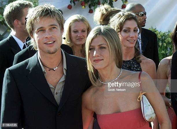 Actress Jennifer Aniston nominated for 'Supporting Actress Comedy Series' for her role in the comedy 'Friends' poses with her husband Brad Pitt...