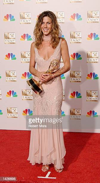 Actress Jennifer Aniston poses with her Outstanding Lead Actress in a Comedy Series award for 'Friends' backstage during the 54th Annual Primetime...