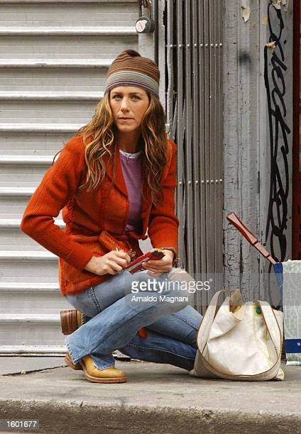 Actress Jennifer Aniston relaxes on the comedy set of a new unnamed movie November 10 2002 in New York City Actor Ben Stiller costars with Aniston