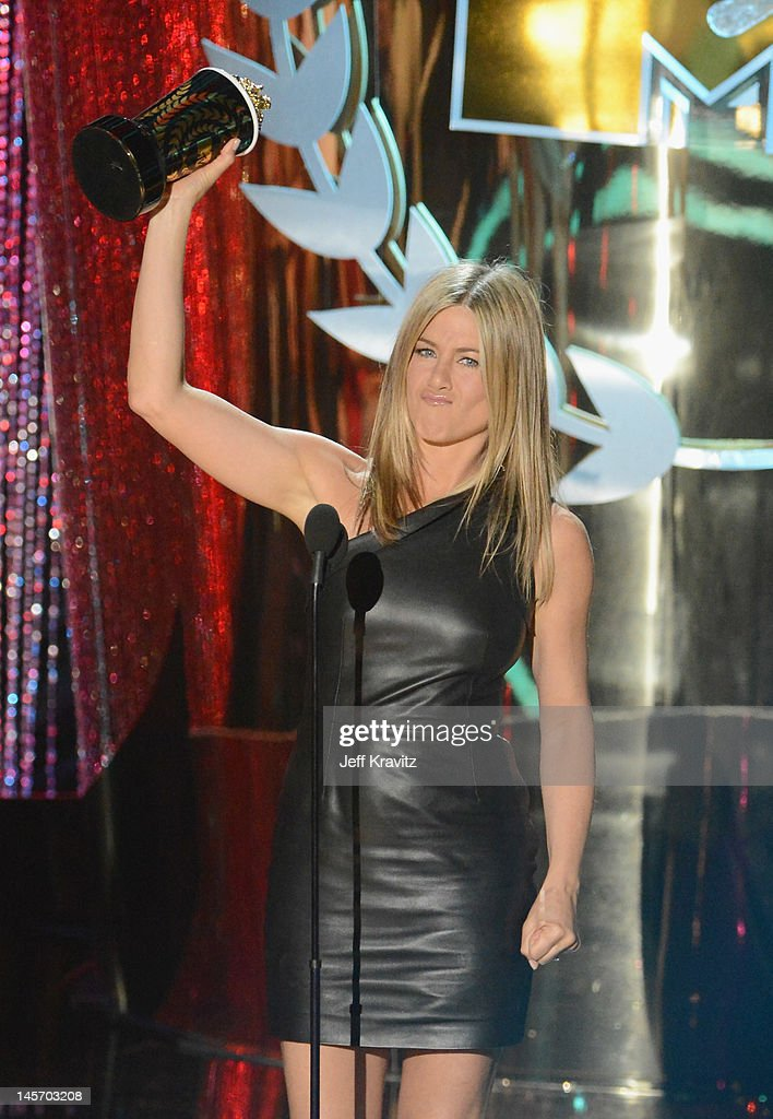 Actress <a gi-track='captionPersonalityLinkClicked' href=/galleries/search?phrase=Jennifer+Aniston&family=editorial&specificpeople=202048 ng-click='$event.stopPropagation()'>Jennifer Aniston</a> speaks onstage at the 2012 MTV Movie Awards at Gibson Amphitheatre on June 3, 2012 in Universal City, California.