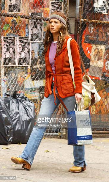 Actress Jennifer Aniston walks on the comedy set of a new unnamed movie November 10 2002 in New York City Actor Ben Stiller costars with Aniston