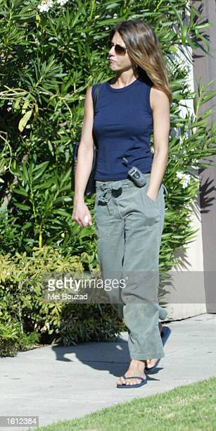 Actress Jennifer Aniston window shops at an antique store October 3 2002 in Beverly Hills California