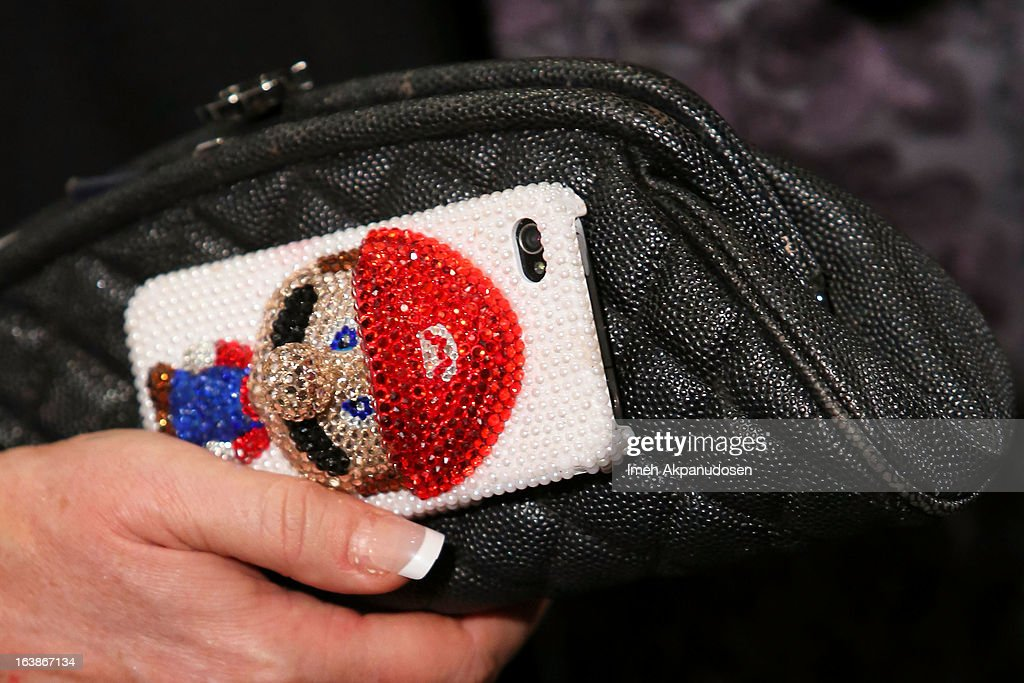 Actress Jennifer Coolidge (clutch and phone case detail) attends the Fun For Animals Celebrity Poker Tournament & Cocktail Party at Petersen Automotive Museum on March 16, 2013 in Los Angeles, California.