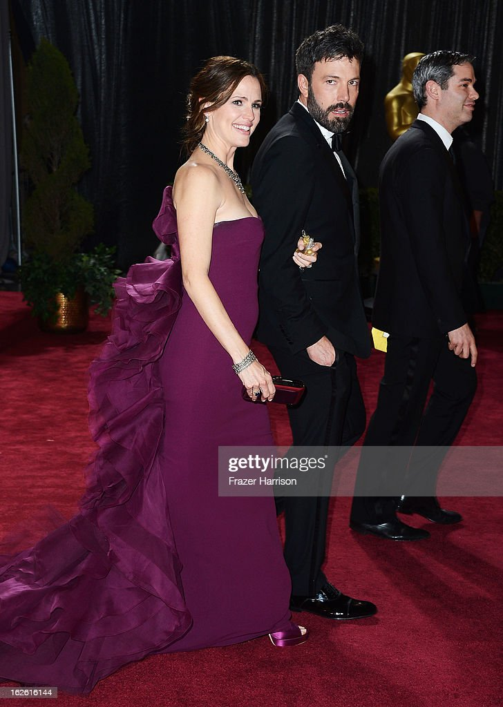 Actress Jennifer Garner (L) and actor/director Ben Affleck (C), winner of Best Picture for 'Argo', departs the Oscars at Hollywood & Highland Center on February 24, 2013 in Hollywood, California.