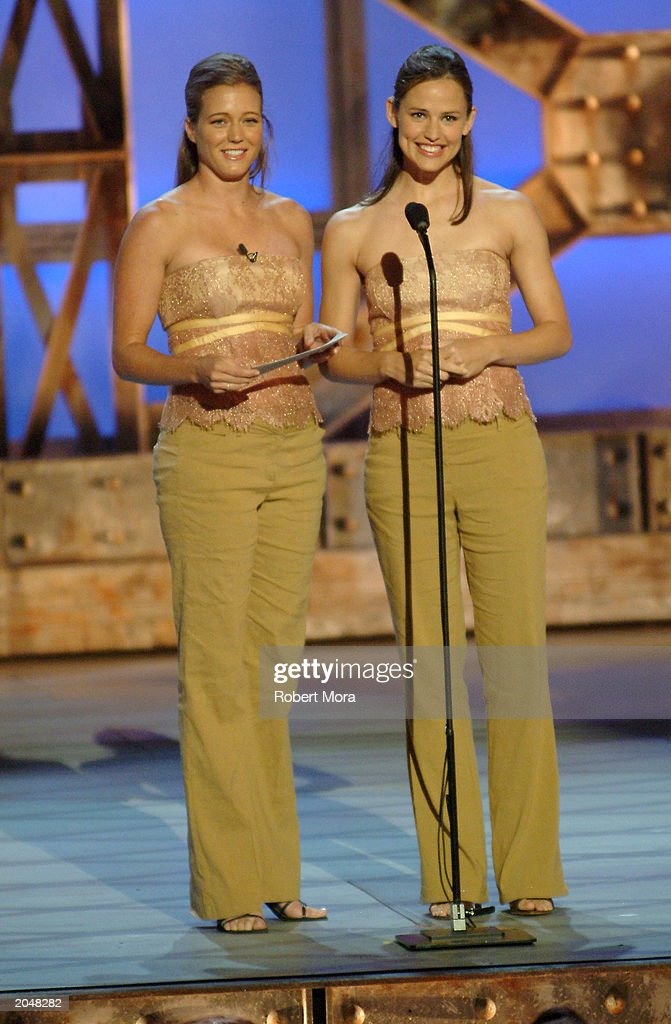 Actress <a gi-track='captionPersonalityLinkClicked' href=/galleries/search?phrase=Jennifer+Garner&family=editorial&specificpeople=201813 ng-click='$event.stopPropagation()'>Jennifer Garner</a> (R) and her stunt double Shanna Duggins present the 'Best Overall Stunt by a Woman' award for the film 'Die Another Day' on stage during the 3rd Annual Taurus World Stunt Awards at Paramount Studios June 1, 2003 in Hollywood, California. The show will air Monday, June 9th, 8:00 pm EST/PST on the USA Network.