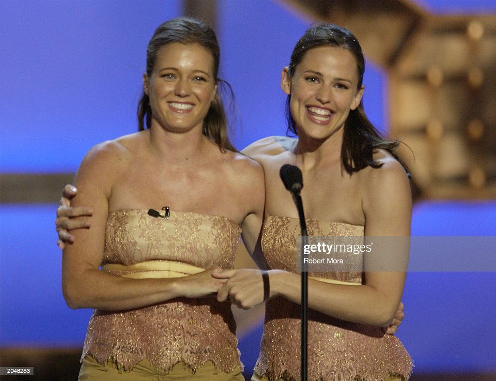 Actress <a gi-track='captionPersonalityLinkClicked' href=/galleries/search?phrase=Jennifer+Garner&family=editorial&specificpeople=201813 ng-click='$event.stopPropagation()'>Jennifer Garner</a> (R) and her stunt double Shanna Duggins present the 'Best Overall Stunt by a Woman' award on stage during the 3rd Annual Taurus World Stunt Awards at Paramount Studios June 1, 2003 in Hollywood, California. The show will air Monday, June 9th, 8:00 pm EST/PST on the USA Network.