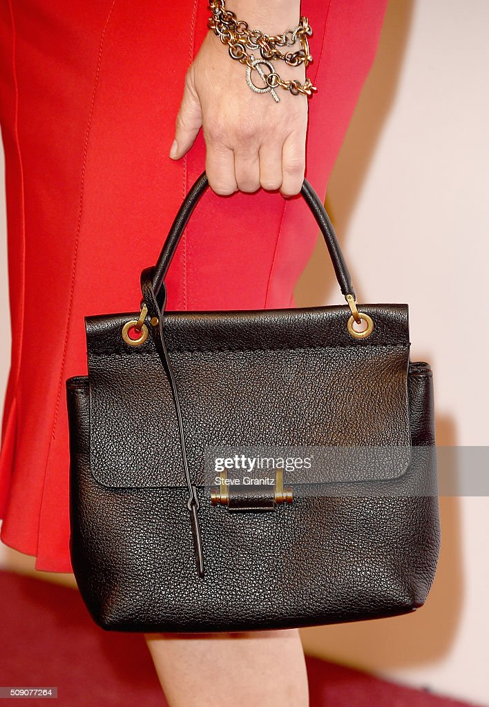 Actress <a gi-track='captionPersonalityLinkClicked' href=/galleries/search?phrase=Jennifer+Jason+Leigh&family=editorial&specificpeople=208958 ng-click='$event.stopPropagation()'>Jennifer Jason Leigh</a>, bracelet, purse and fashion details, attends the 88th Annual Academy Awards nominee luncheon on February 8, 2016 in Beverly Hills, California.