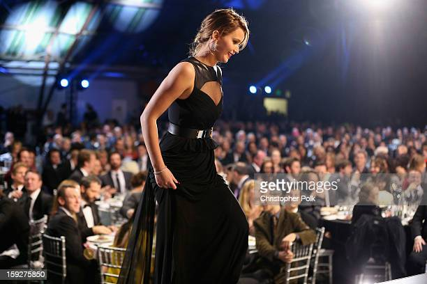 Actress Jennifer Lawrence accepts the award for Best Actress in an Action Movie onstage at the 18th Annual Critics' Choice Movie Awards held at...