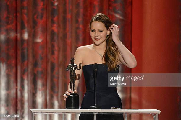 Actress Jennifer Lawrence accepts the award for Outstanding Performance by a Female Actor in a Leading Role for 'Silver Linings Playbook' onstage...