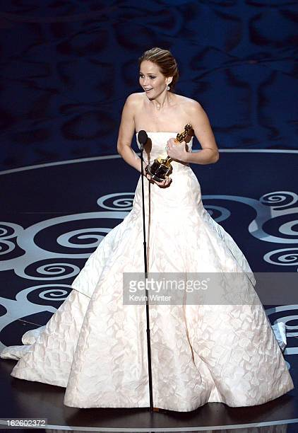 Actress Jennifer Lawrence accepts the Best Actress award for 'Silver Linings Playbook' during the Oscars held at the Dolby Theatre on February 24...