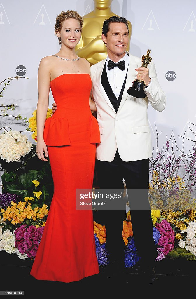Actress Jennifer Lawrence (L) and actor Matthew McConaughey pose in the press room during the Oscars at Loews Hollywood Hotel on March 2, 2014 in Hollywood, California.