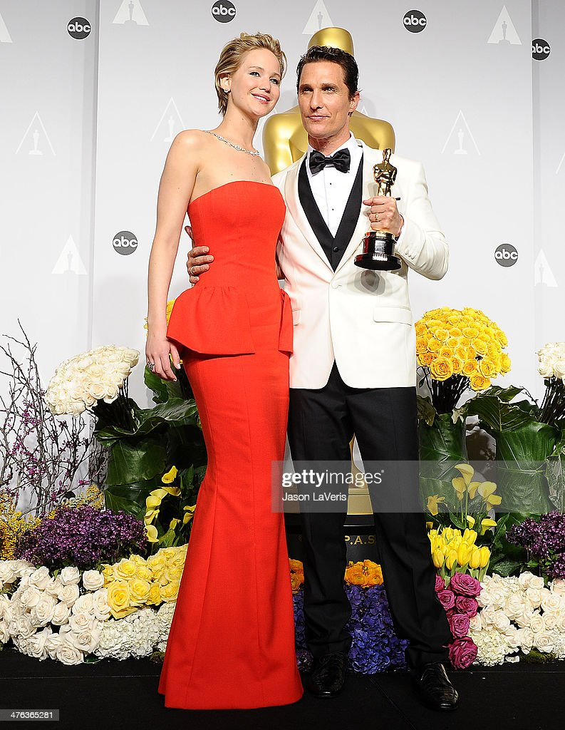 Actress Jennifer Lawrence and actor Matthew McConaughey pose in the press room at the 86th annual Academy Awards at Dolby Theatre on March 2, 2014 in Hollywood, California.