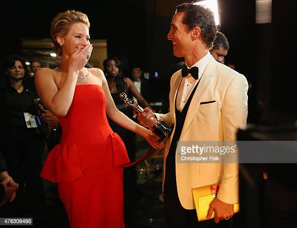 Actress Jennifer Lawrence and Best Actor Award winner Matthew McConaughey backstage during the Oscars held at Dolby Theatre on March 2 2014 in...