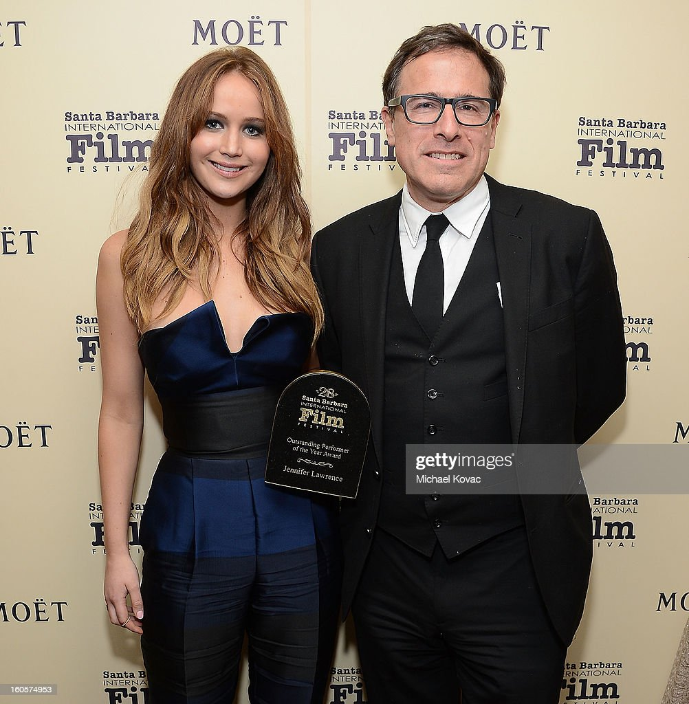 Actress <a gi-track='captionPersonalityLinkClicked' href=/galleries/search?phrase=Jennifer+Lawrence&family=editorial&specificpeople=1596040 ng-click='$event.stopPropagation()'>Jennifer Lawrence</a> and director <a gi-track='captionPersonalityLinkClicked' href=/galleries/search?phrase=David+O.+Russell&family=editorial&specificpeople=215306 ng-click='$event.stopPropagation()'>David O. Russell</a> visit The Moet & Chandon Lounge after she received the Outstanding Performer of the Year Award at The Santa Barbara International Film Festival on February 2, 2013 in Santa Barbara, California.
