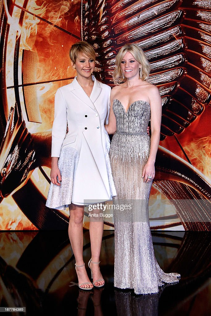 Actress Jennifer Lawrence (L) and Elizabeth Banks attend the Germany premiere of the film 'The Hunger Games - Catching Fire' (Tribute von Panem - Catching Fire) at Sony Centre on November 12, 2013 in Berlin, Germany.