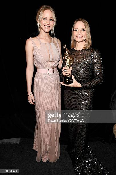 Actress Jennifer Lawrence and honoree Jodie Foster recipient of the Stanley Kubrick Britannia Award for Excellence in Film attend the 2016 AMD...