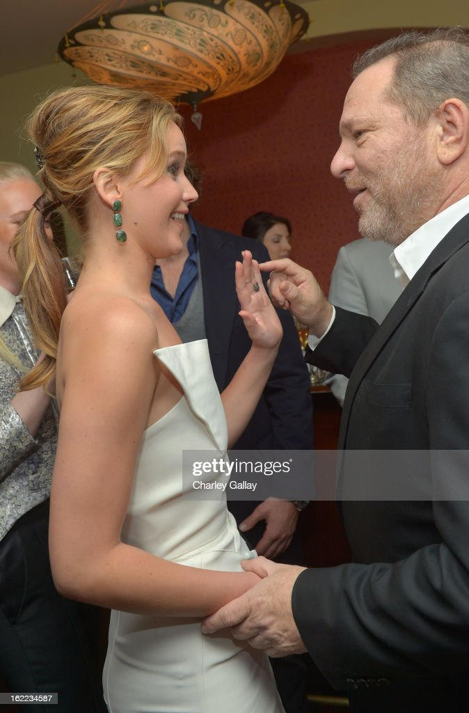 Actress <a gi-track='captionPersonalityLinkClicked' href=/galleries/search?phrase=Jennifer+Lawrence&family=editorial&specificpeople=1596040 ng-click='$event.stopPropagation()'>Jennifer Lawrence</a> (L) and producer <a gi-track='captionPersonalityLinkClicked' href=/galleries/search?phrase=Harvey+Weinstein&family=editorial&specificpeople=201749 ng-click='$event.stopPropagation()'>Harvey Weinstein</a> attend the Vanity Fair, Barneys New York and The Weinstein Company celebration of 'Silver Linings Playbook' in support of The Glenholme School on February 20, 2013 in Los Angeles, California
