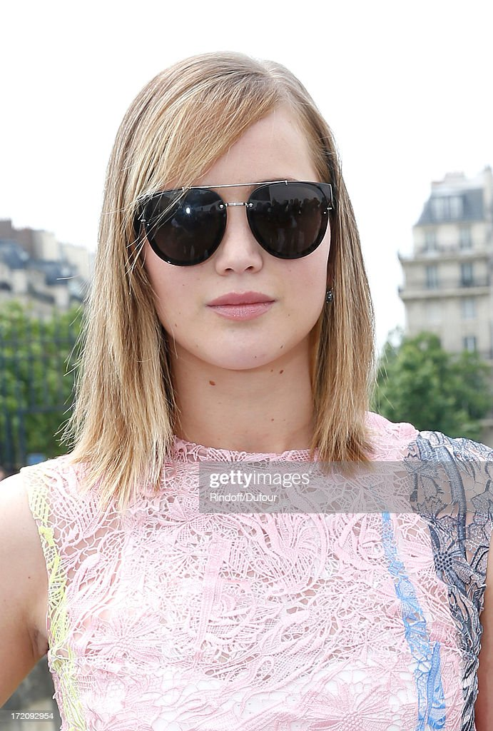 Actress <a gi-track='captionPersonalityLinkClicked' href=/galleries/search?phrase=Jennifer+Lawrence&family=editorial&specificpeople=1596040 ng-click='$event.stopPropagation()'>Jennifer Lawrence</a> arrives at the Christian Dior show as part of Paris Fashion Week Haute-Couture Fall/Winter 2013-2014 at on July 1, 2013 in Paris, France.