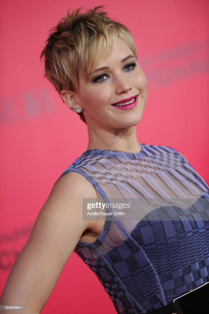 Actress <a gi-track='captionPersonalityLinkClicked' href=/galleries/search?phrase=Jennifer+Lawrence&family=editorial&specificpeople=1596040 ng-click='$event.stopPropagation()'>Jennifer Lawrence</a> arrives at the Los Angeles Premiere of 'The Hunger Games: Catching Fire' at Nokia Theatre L.A. Live on November 18, 2013 in Los Angeles, California.