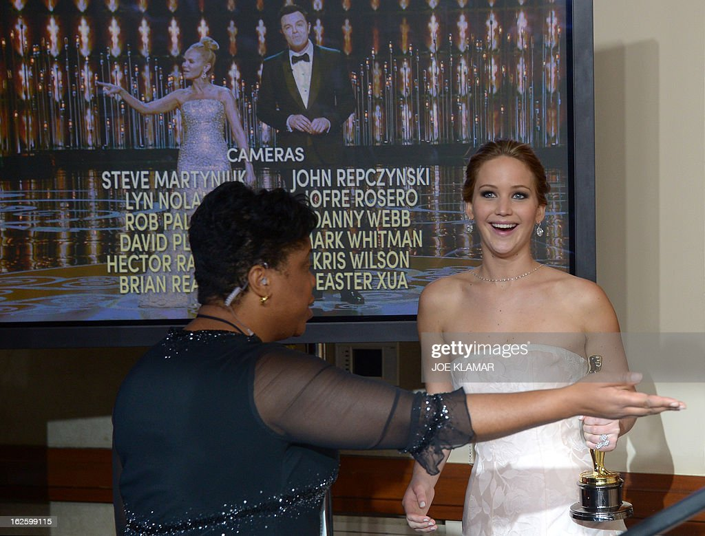 Actress Jennifer Lawrence arrives in the press room after winning the Oscar for best actress at the 85th Annual Academy Awards on February 24, 2013 in Hollywood, California. AFP PHOTO / JOE KLAMAR