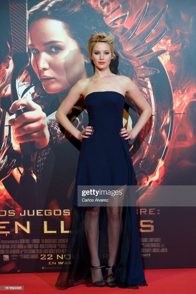 Actress <a gi-track='captionPersonalityLinkClicked' href=/galleries/search?phrase=Jennifer+Lawrence&family=editorial&specificpeople=1596040 ng-click='$event.stopPropagation()'>Jennifer Lawrence</a> attenda the Spanish premiere of the film 'The Hunger Games - Catching Fire' (Los Juegos Del Hambre: En Llamas) at the Callao cinema on November 13, 2013 in Madrid, Spain.