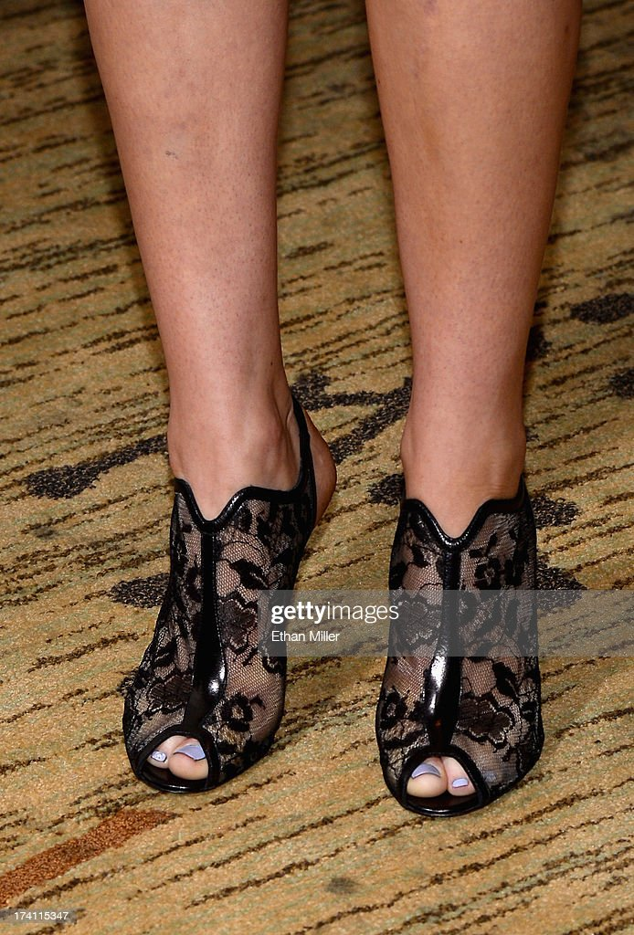 Actress Jennifer Lawrence (shoe detail) attends Lionsgate's 'The Hunger Games: Catching Fire' and 'I, Frankenstein' press line during Comic-Con International 2013 at the Hilton Bayfront on July 20, 2013 in San Diego, California.