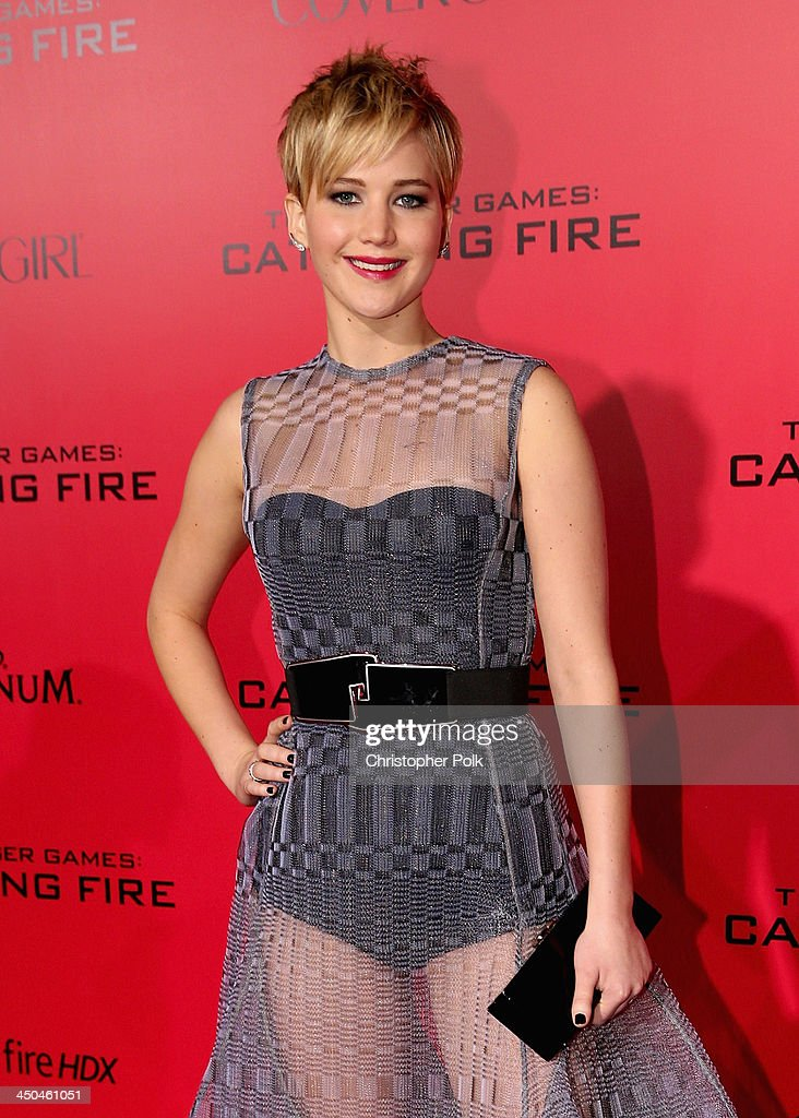 Actress <a gi-track='captionPersonalityLinkClicked' href=/galleries/search?phrase=Jennifer+Lawrence&family=editorial&specificpeople=1596040 ng-click='$event.stopPropagation()'>Jennifer Lawrence</a> attends premiere of Lionsgate's 'The Hunger Games: Catching Fire' - Red Carpet at Nokia Theatre L.A. Live on November 18, 2013 in Los Angeles, California.