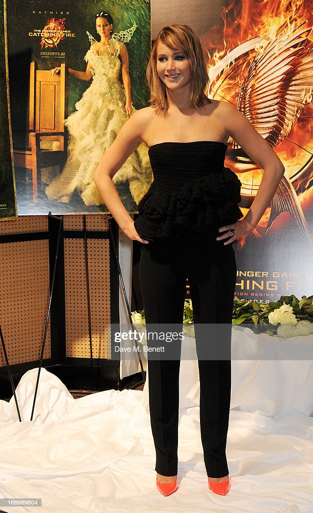 Actress <a gi-track='captionPersonalityLinkClicked' href=/galleries/search?phrase=Jennifer+Lawrence&family=editorial&specificpeople=1596040 ng-click='$event.stopPropagation()'>Jennifer Lawrence</a> attends The Hunger Games: Catching Fire photocall at the 2013 Cannes Film Festival at Majestic Barierre on May 18, 2013 in Cannes, France.