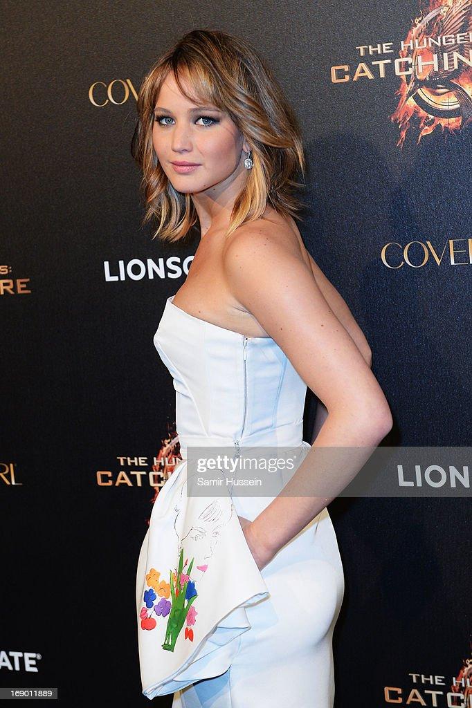 Actress <a gi-track='captionPersonalityLinkClicked' href=/galleries/search?phrase=Jennifer+Lawrence&family=editorial&specificpeople=1596040 ng-click='$event.stopPropagation()'>Jennifer Lawrence</a> attends 'The Hunger Games: Catching Fire' Party during The 66th Annual Cannes Film Festival at Baoli Beach on May 18, 2013 in Cannes, France.