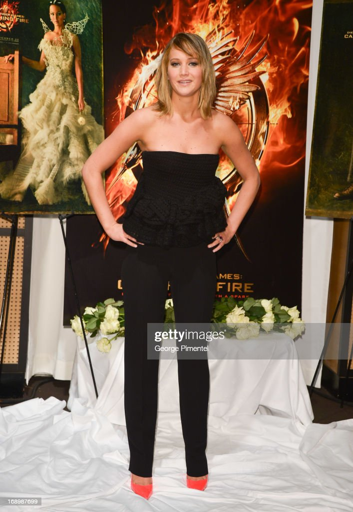 Actress <a gi-track='captionPersonalityLinkClicked' href=/galleries/search?phrase=Jennifer+Lawrence&family=editorial&specificpeople=1596040 ng-click='$event.stopPropagation()'>Jennifer Lawrence</a> attends the photocall for 'The Hunger Games: Catching Fire' at The 66th Annual Cannes Film Festival at Majestic Hotel on May 18, 2013 in Cannes, France.