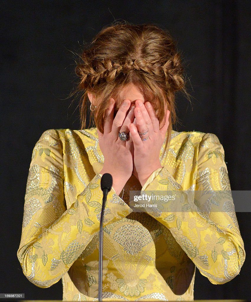 Actress Jennifer Lawrence buries her head in her hands after accepting the award for best actress at the 38th Annual Los Angeles Film Critics Association Awards - Show at InterContinental Hotel on January 12, 2013 in Century City, California.