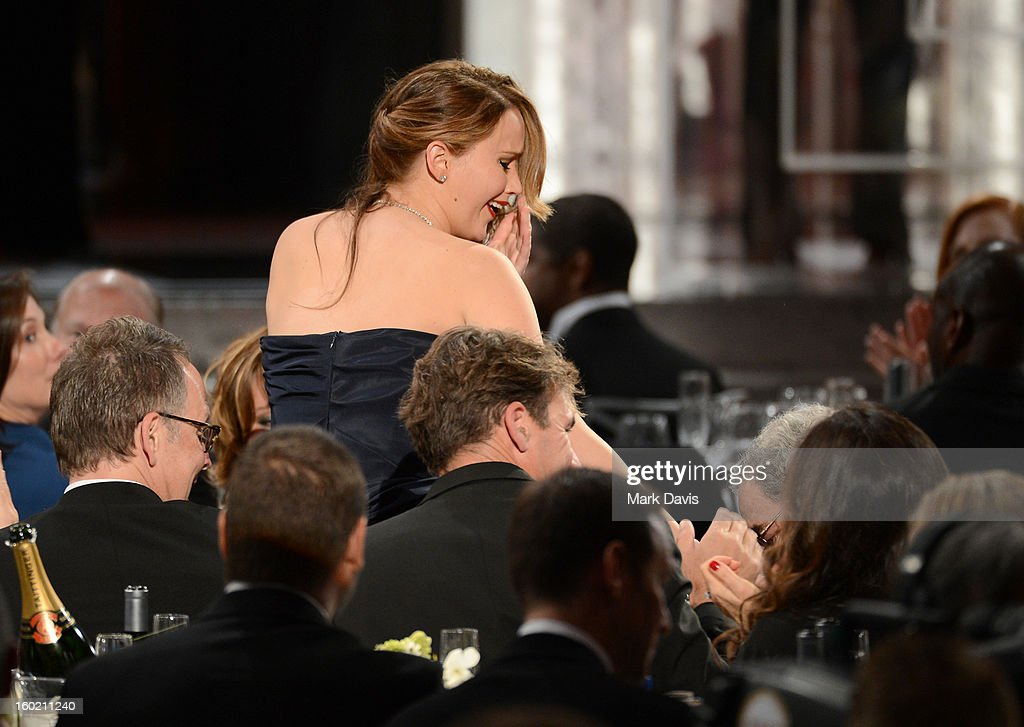 Actress <a gi-track='captionPersonalityLinkClicked' href=/galleries/search?phrase=Jennifer+Lawrence&family=editorial&specificpeople=1596040 ng-click='$event.stopPropagation()'>Jennifer Lawrence</a> is congratulated after winning the award for Outstanding Performance by a Female Actor in a Leading Role for 'Silver Linings Playbook' during the 19th Annual Screen Actors Guild Awards held at The Shrine Auditorium on January 27, 2013 in Los Angeles, California.