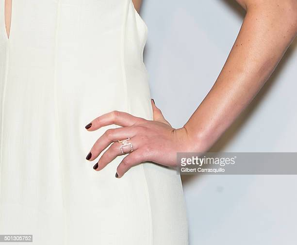 Actress Jennifer Lawrence jewelry detail attends the 'Joy' New York premiere at Ziegfeld Theater on December 13 2015 in New York City