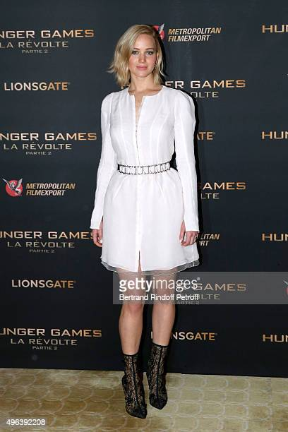 Actress Jennifer Lawrence makeup and dressed in Dior attends the 'Hunger Games Mockingjay Part 2' Paris Photocall at Plazza Athenee on November 9...