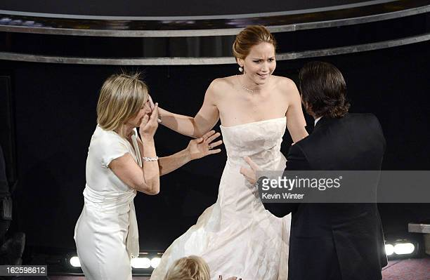 Actress Jennifer Lawrence mother Karen Lawrence and actor Bradley Cooper celebrate after Lawrence wins the Best Actress award for 'Silver Linings...