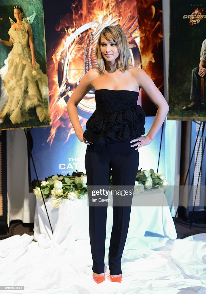Actress <a gi-track='captionPersonalityLinkClicked' href=/galleries/search?phrase=Jennifer+Lawrence&family=editorial&specificpeople=1596040 ng-click='$event.stopPropagation()'>Jennifer Lawrence</a> poses at the 'The Hunger Games: Catching Fire' photocall during The 66th Annual Cannes Film Festival at Nespresso Beach on May 18, 2013 in Cannes, France.