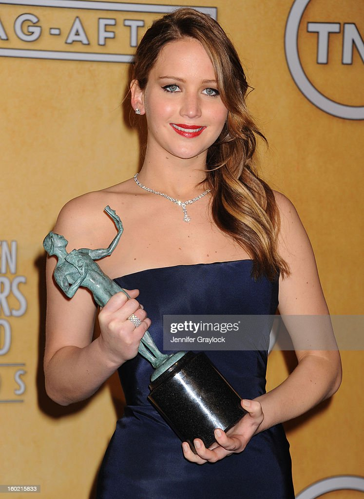 Actress <a gi-track='captionPersonalityLinkClicked' href=/galleries/search?phrase=Jennifer+Lawrence&family=editorial&specificpeople=1596040 ng-click='$event.stopPropagation()'>Jennifer Lawrence</a> poses in the press room at the 19th Annual Screen Actors Guild Awards at The Shrine Auditorium on January 27, 2013 in Los Angeles, California.