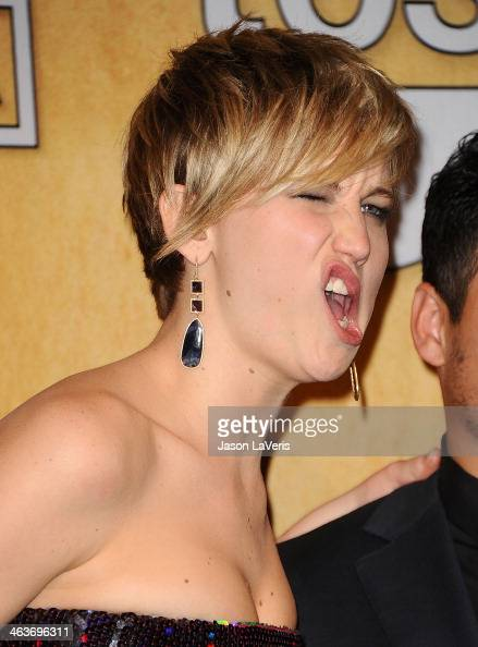 Actress Jennifer Lawrence poses in the press room at the 20th annual Screen Actors Guild Awards at The Shrine Auditorium on January 18 2014 in Los...