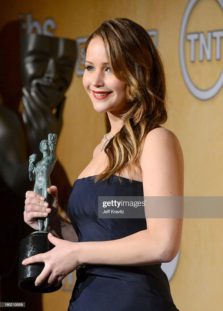 Actress <a gi-track='captionPersonalityLinkClicked' href=/galleries/search?phrase=Jennifer+Lawrence&family=editorial&specificpeople=1596040 ng-click='$event.stopPropagation()'>Jennifer Lawrence</a> poses in the press room during the 19th Annual Screen Actors Guild Awards held at The Shrine Auditorium on January 27, 2013 in Los Angeles, California.