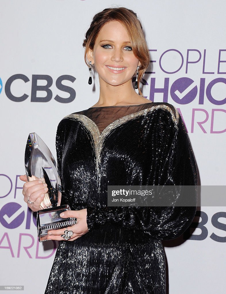 Actress Jennifer Lawrence poses in the pressroom at the 2013 People's Choice Awards at Nokia Theatre L.A. Live on January 9, 2013 in Los Angeles, California.