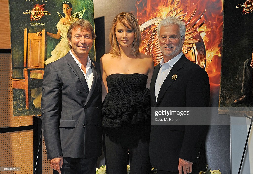 Actress <a gi-track='captionPersonalityLinkClicked' href=/galleries/search?phrase=Jennifer+Lawrence&family=editorial&specificpeople=1596040 ng-click='$event.stopPropagation()'>Jennifer Lawrence</a> (C) poses with Lionsgate Motion Picture Group Co-Chairmen Patrick Wachsberger (L) and <a gi-track='captionPersonalityLinkClicked' href=/galleries/search?phrase=Rob+Friedman&family=editorial&specificpeople=234962 ng-click='$event.stopPropagation()'>Rob Friedman</a> at The Hunger Games: Catching Fire photocall at the 2013 Cannes Film Festival at Majestic Barierre on May 18, 2013 in Cannes, France.